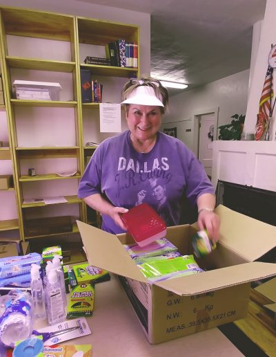 Janice-Shively-sorting-school-supplies