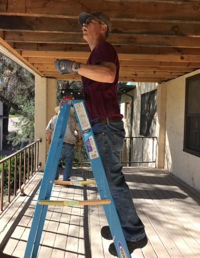 Leon Wright removing a porch ceiling